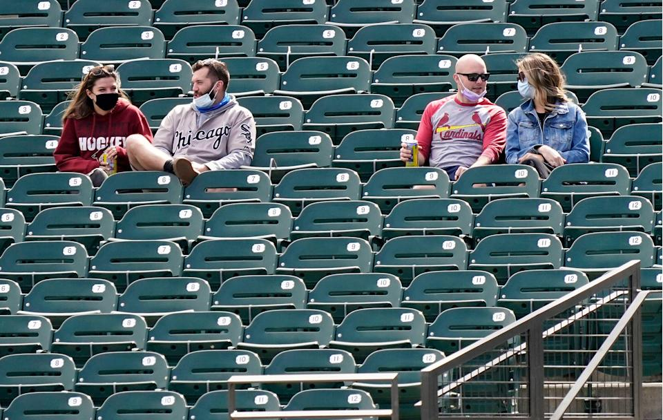 Socially distanced fans attend a baseball game during a spring training game at Salt River Fields at Talking Stick in Arizona.