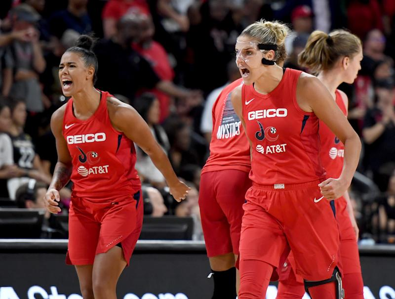 LAS VEGAS, NEVADA - SEPTEMBER 24: Natasha Cloud (L) #9 and Elena Delle Donne #11 of the Washington Mystics react after the team scored against the Las Vegas Aces during Game Four of the 2019 WNBA Playoff semifinals at the Mandalay Bay Events Center on September 24, 2019 in Las Vegas, Nevada. The Mystics defeated the Aces 94-90 and won the series 3-1. NOTE TO USER: User expressly acknowledges and agrees that, by downloading and or using this photograph, User is consenting to the terms and conditions of the Getty Images License Agreement. (Photo by Ethan Miller/Getty Images)
