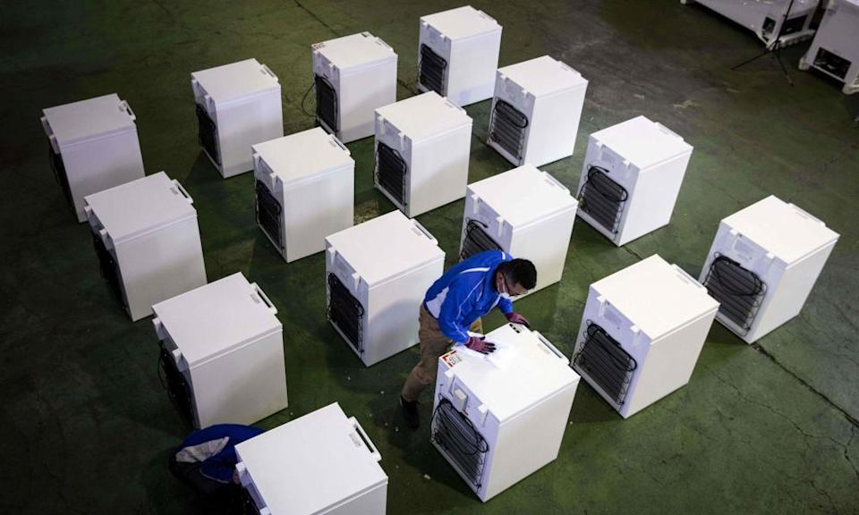 A manager at fridge manufacturer Kanou Reiki checks deep freezers that will be used to store Covid vaccines at the company's warehouse in Sagamihara, Kanagawa prefecture