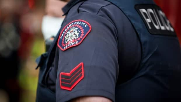 Const. Benjamin Zampa, who has been with CPS for four years,is charged with assault and is currently on administrative duties. (Jeff McIntosh/The Canadian Press - image credit)