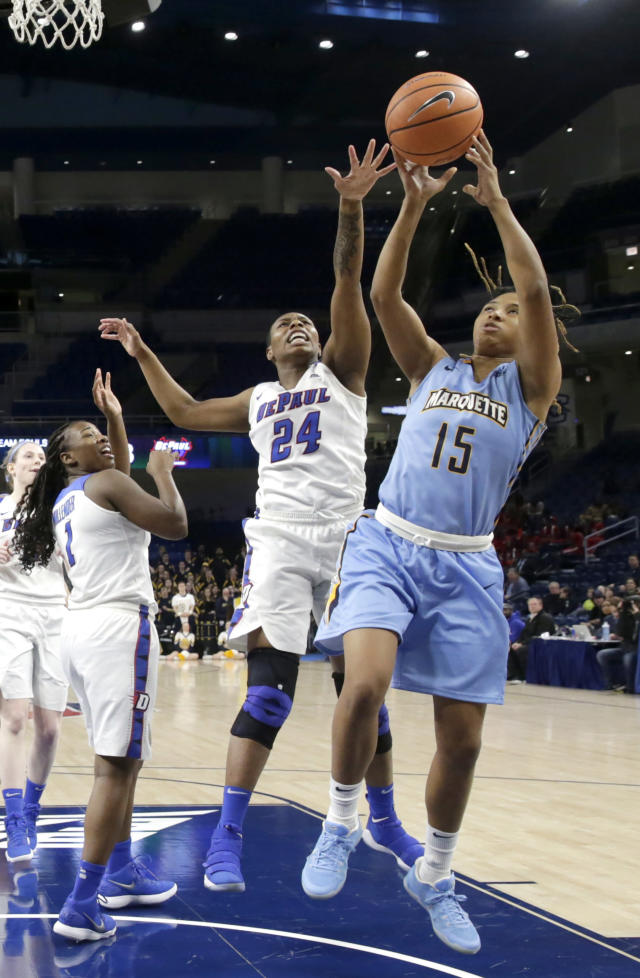 DePaul's Tanita Allen (24) knocks the ball out of Marquette's Amani Wilborn (15) hands during the first half of an NCAA college basketball game in the championship of the Big East conference tournament, Tuesday, March 6, 2018, in Chicago. (AP Photo/Charles Rex Arbogast)