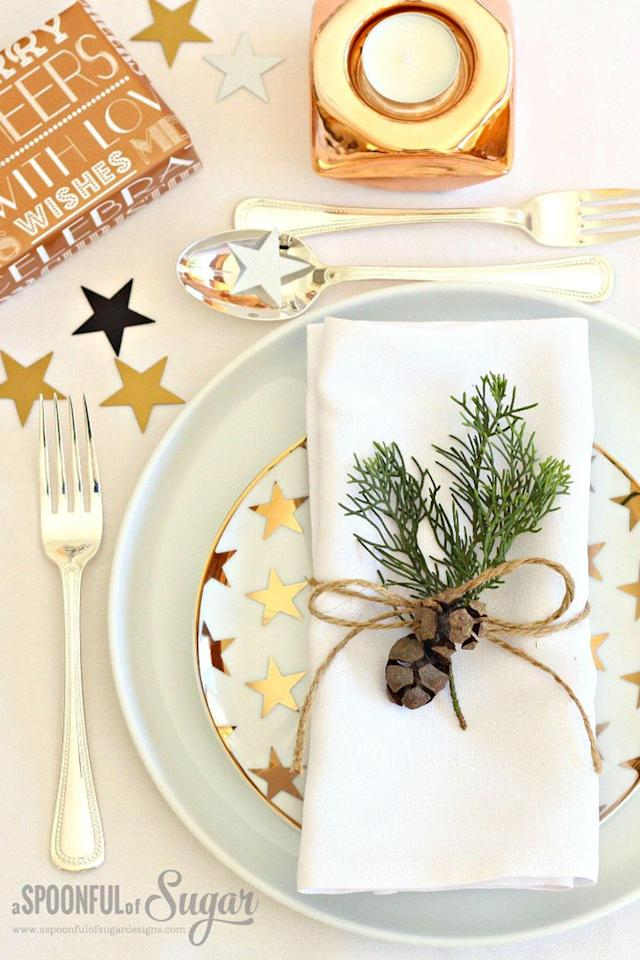 """<p>Subtle touches are something to celebrate—they add festive charm to your table, and these are no exception. Use a craft punch to cut out stars and scatter them around your plate settings.</p><p><strong>Get the tutorial at <a href=""""http://aspoonfulofsugardesigns.com/2015/12/10-simple-christmas-table-ideas/"""" rel=""""nofollow noopener"""" target=""""_blank"""" data-ylk=""""slk:A Spoonful of Sugar"""" class=""""link rapid-noclick-resp"""">A Spoonful of Sugar</a>. </strong></p><p><strong><a class=""""link rapid-noclick-resp"""" href=""""https://www.amazon.com/Fiskars-Corporation-Star-Punch-23537097J/dp/B071XGD7YC/?tag=syn-yahoo-20&ascsubtag=%5Bartid%7C10050.g.644%5Bsrc%7Cyahoo-us"""" rel=""""nofollow noopener"""" target=""""_blank"""" data-ylk=""""slk:SHOP STAR PUNCH"""">SHOP STAR PUNCH</a></strong></p>"""