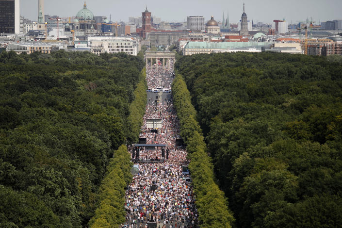 People gather at the Brandenburg gate for a demonstration with the slogan 'The end of the pandemic - freedom day' - against coronavirus restrictions in Berlin, Germany, Saturday, Aug. 1, 2020. It comes amid increasing concern about an upturn in infections in Germany. (AP Photo/Markus Schreiber)