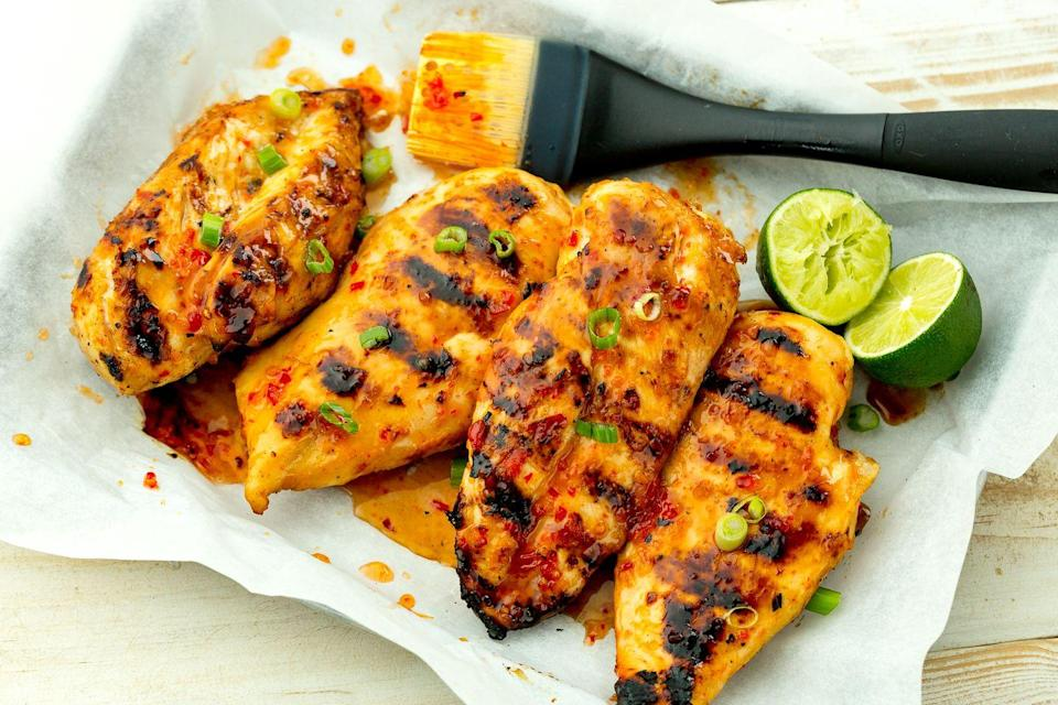 """<p>Grilled chicken gets a punch of flavor from sticky sweet-chili sauce.</p><p>Get the recipe from <a href=""""https://www.delish.com/cooking/recipe-ideas/recipes/a47356/sweet-chili-lime-grilled-chicken-recipe/"""" rel=""""nofollow noopener"""" target=""""_blank"""" data-ylk=""""slk:Delish"""" class=""""link rapid-noclick-resp"""">Delish</a>.</p>"""