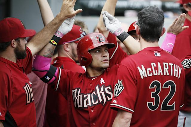 Arizona Diamondbacks' Gerardo Parra, center, celebrates after hitting a two-run home run against the Chicago White Sox during the fifth inning of a baseball game on Sunday, May 11, 2014, in Chicago. (AP Photo/Andrew A. Nelles)