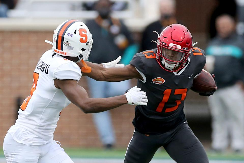 National Team wide receiver Desmond Fitzpatrick of Louisville (13) stiff arms American Team wide receiver Trevon Grimes of Florida (8) during the second half of the NCAA college football Senior Bowl in Mobile, Ala, Saturday, Jan. 30, 2021.