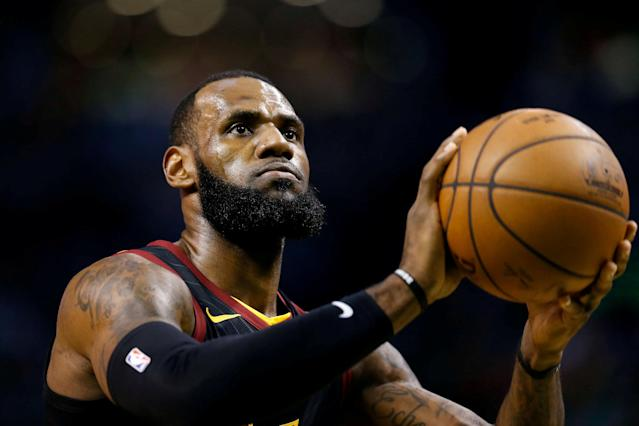 FILE PHOTO: May 23, 2018; Boston, MA, USA; Cleveland Cavaliers forward LeBron James (23) attempts a free throw against the Boston Celtics during the first quarter of game five of the Eastern conference finals of the 2018 NBA Playoffs at TD Garden. Mandatory Credit: Greg M. Cooper-USA TODAY Sports/File Photo