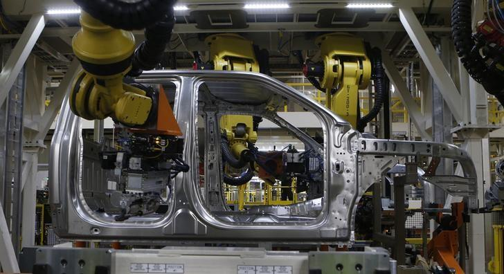 The aluminium cab of an all-new Ford 2015 F-150 pickup truck is seen on the new robot assembly line at the Ford Rouge Center in Dearborn