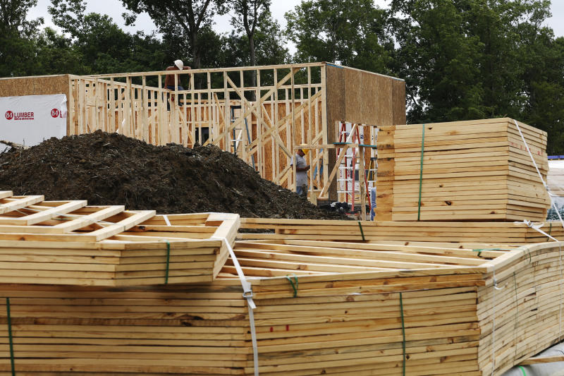 In this June 13, 2019, photo work continues on a new home in Mechanicsville, Va. On Tuesday, June 18, the Commerce Department reports on U.S. home construction in May. (AP Photo/Steve Helber)