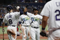 Tampa Bay Rays' Francisco Mejia celebrates his two-run home run with Brandon Lowe (8) during the fourth inning of a baseball game against the Boston Red Sox on Saturday, July 31, 2021, in St. Petersburg, Fla. (AP Photo/Scott Audette)