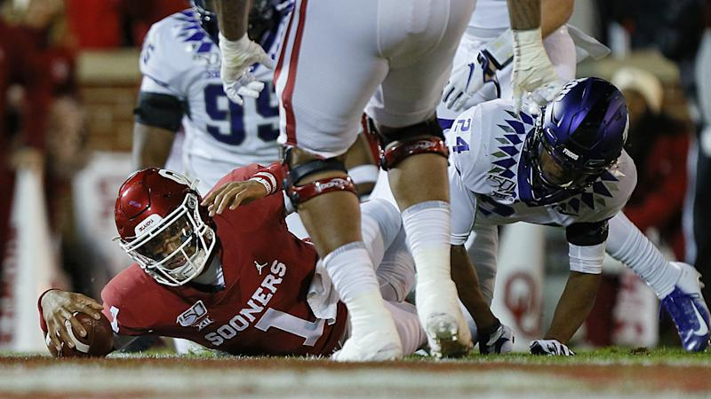 Oklahoma outlasts TCU with controversial first-down call from refs
