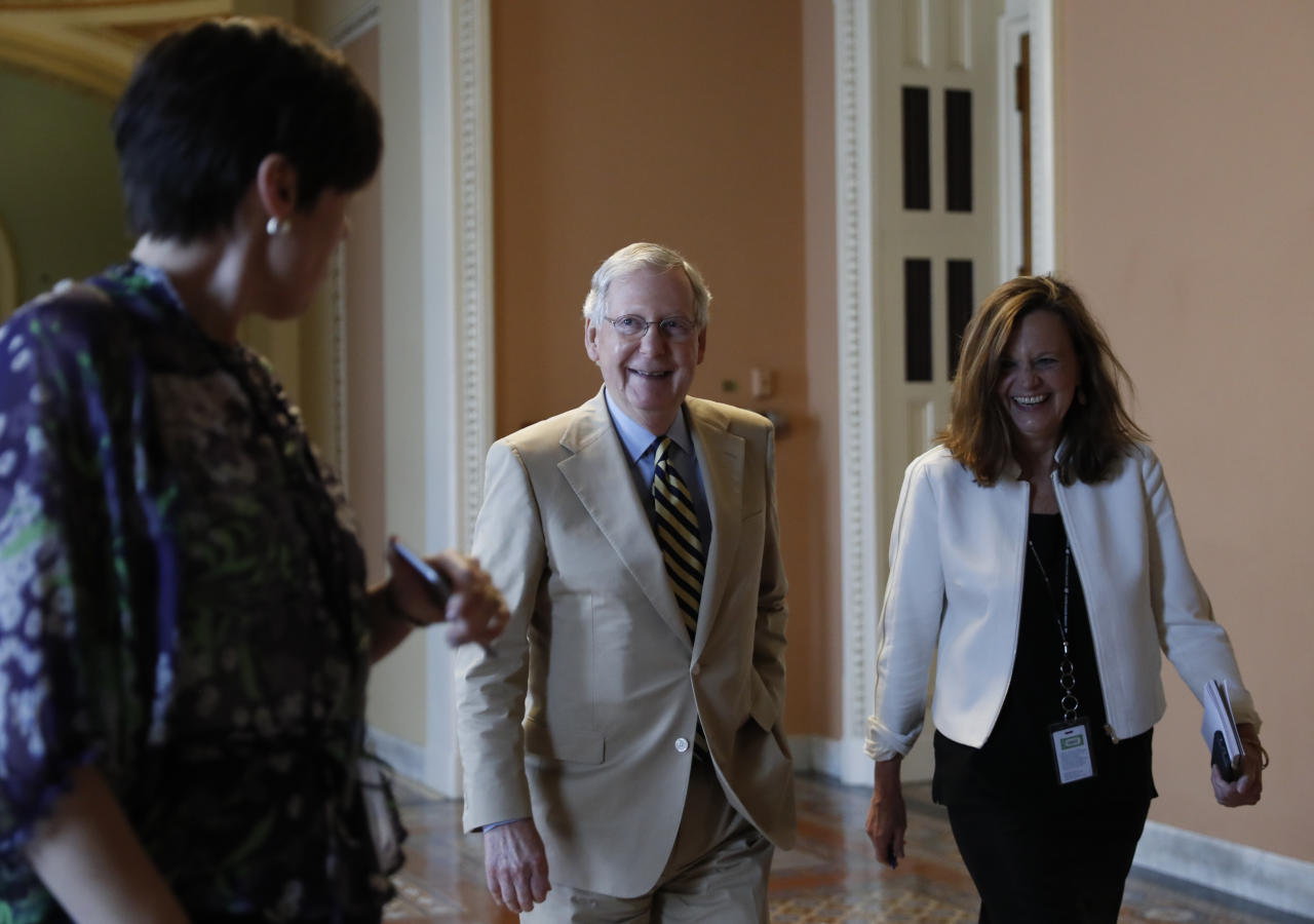 "<p> Senate Majority Leader Mitch McConnell of Ky., center, talks with his chief of staff Sharon Soderstrom, right, and communications staff director Antonia Ferrier, left, as they walk to his office on Capitol Hill in Washington, Monday, June 26, 2017. Senate Republicans unveil a revised health care bill in hopes of securing support from wavering GOP lawmakers, including one who calls the drive to whip his party's bill through the Senate this week ""a little offensive."" (AP Photo/Carolyn Kaster) </p>"