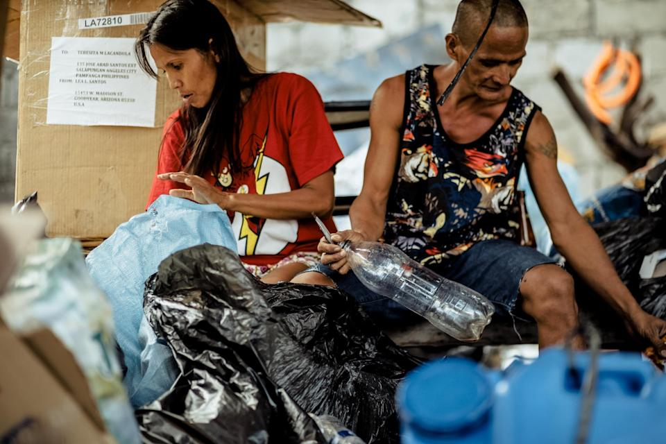 Rommel and Rosalyn make a living by collecting plastic scraps and selling them. (Photo reproduced with permission from Rab4Love Studios)