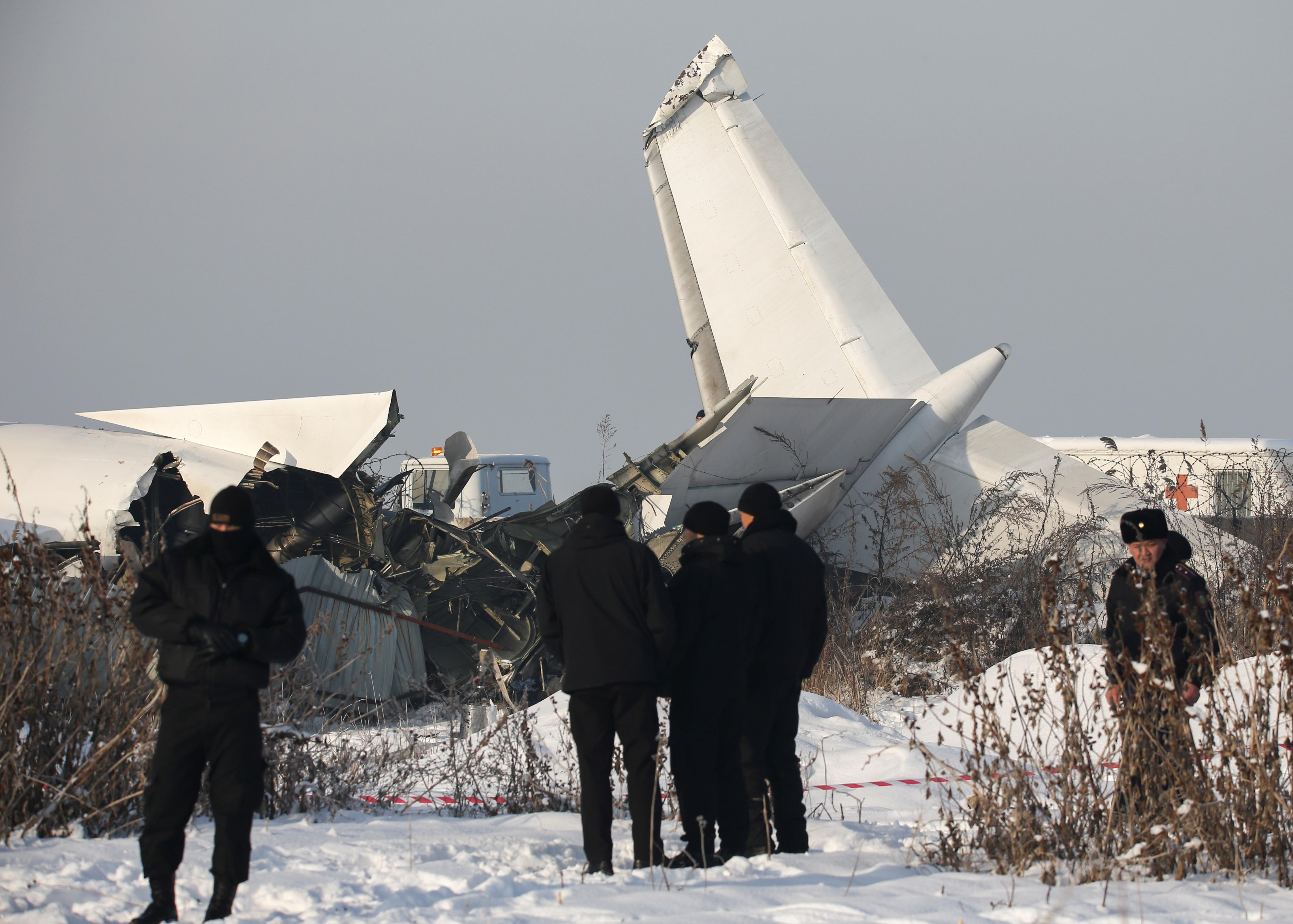 Emergency and security personnel are seen at the site of a plane crash near Almaty, Kazakhstan, December 27, 2019. REUTERS/Pavel Mikheyev