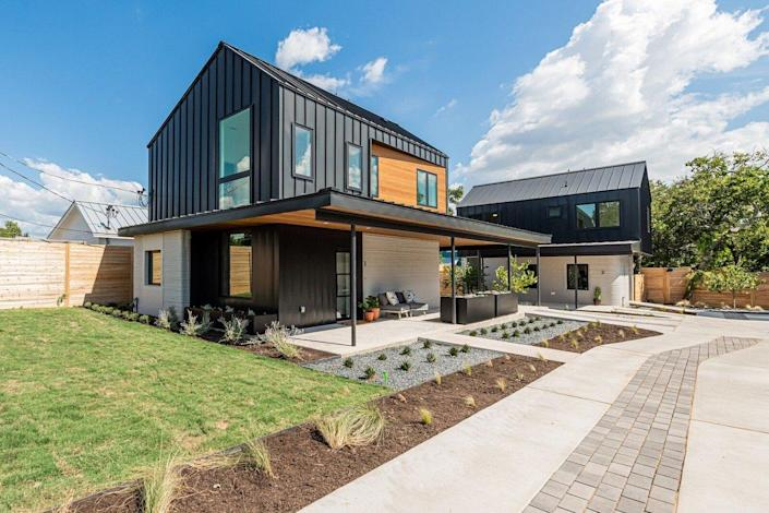 View of the first community in the 3D printed homes market in the United States.  Designed by Logan Architecture and built by ICON in Austin, Texas.