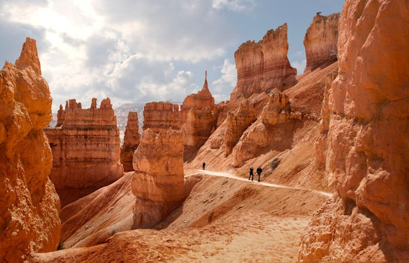 """Quick! How many National parks are in the state of Utah? The answer is FIVE! Five stunning jewels featuring mind-blowing, surreal landscapes with canyons, arches, sheer cliffs, hanging gardens and <a href=""""https://en.wikipedia.org/wiki/Hoodoo_(geology)"""">hoodoos.</a> Pick any one of the parks to start, but Zion is closest to McCarran International Airport in Las Vegas. From there, follow where the roads lead you -- through Southeastern Utah to Bryce Canyon, Capitol Reef, Arches and Canyonlands National Parks."""