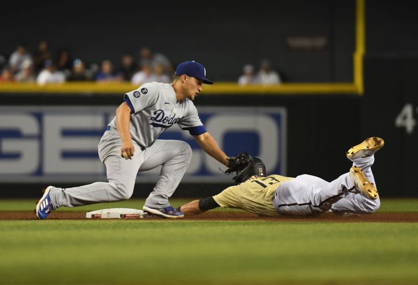 The Diamondbacks' Nick Ahmed steals second base ahead of Dodgers shortstop Corey Seager's tag during the fourth inning.