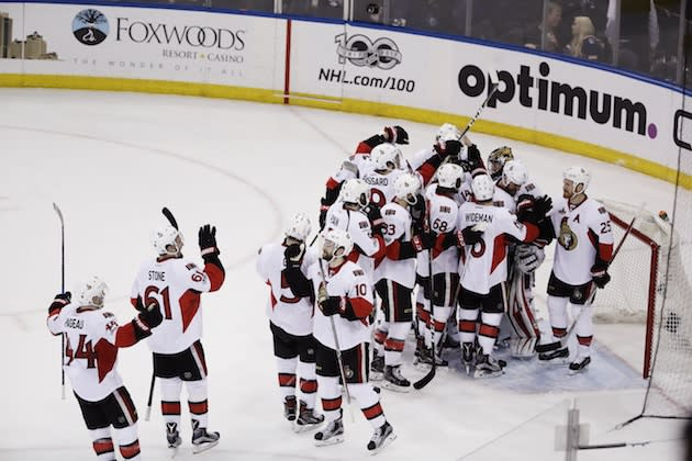 "The <a class=""link rapid-noclick-resp"" href=""/nhl/teams/ott/"" data-ylk=""slk:Ottawa Senators"">Ottawa Senators</a> celebrate after Game 6 of an NHL hockey Stanley Cup second-round playoff series against the <a class=""link rapid-noclick-resp"" href=""/nhl/teams/nyr/"" data-ylk=""slk:New York Rangers"">New York Rangers</a> Tuesday, May 9, 2017, in New York. The Senators won 4-2. (AP Photo/Frank Franklin II)"