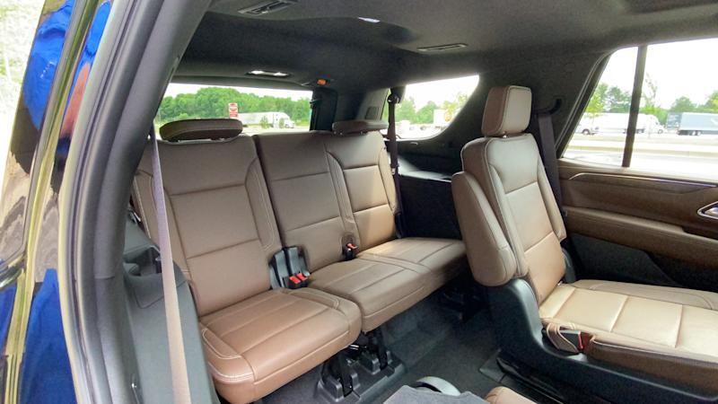 Rear passenger space improves in the 2021 Chevrolet Tahoe. Second-row captain's chairs slide fore and aft, fold flat and tip forward.