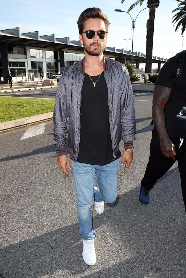 """<p>When your paychecks are dependent on how many headlines you generate, you <a href=""""https://www.yahoo.com/celebrity/bizarre-possible-couple-scott-disick-bella-thorne-fly-off-cannes-together-173624480.html"""" data-ylk=""""slk:fly to Cannes — along with your babe of the week"""" class=""""link rapid-noclick-resp newsroom-embed-article"""">fly to Cannes — along with your babe of the week</a> (see: Bella Thorne) — to stir up trouble with your baby mama ex. That seemed to be <a href=""""https://www.yahoo.com/celebrity/tagged/scott-disick/"""" data-ylk=""""slk:Scott Disick"""" class=""""link rapid-noclick-resp"""">Scott Disick</a>'s m.o. when he touched down at the Nice Côte d'Azur Airport on May 23 with actress Bella Thorne, but he soon <a href=""""https://www.yahoo.com/celebrity/bella-thorne-declares-cannes-apos-013600875.html"""" data-ylk=""""slk:dropped the actess for a hot brunette"""" class=""""link rapid-noclick-resp newsroom-embed-article"""">dropped the actess for a hot brunette</a>. Either way, his presence there will make good fodder for Kourtney's storyline on <em>Keeping Up With the Kardashians — </em>and give the nannies for their three children some serious overtime. (Photo: Alex Huckle/SilverHub/Rex/Shutterstock) </p>"""
