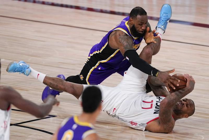 Houston Rockets' P.J. Tucker (17) is fouled by Los Angeles Lakers' LeBron James, left, during the second half of an NBA conference semifinal playoff basketball game Friday, Sept. 4, 2020, in Lake Buena Vista, Fla. (AP Photo/Mark J. Terrill)