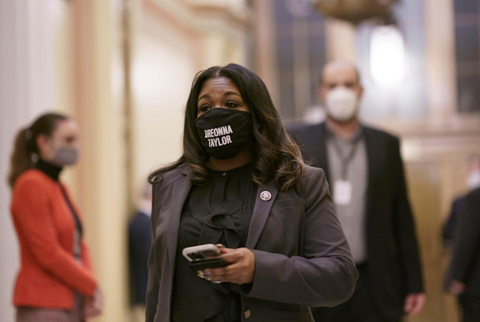 In this Feb. 4, 2021 file photo, Rep. Cori Bush, D-Mo., arrives at the House chamber at the Capitol in Washington.