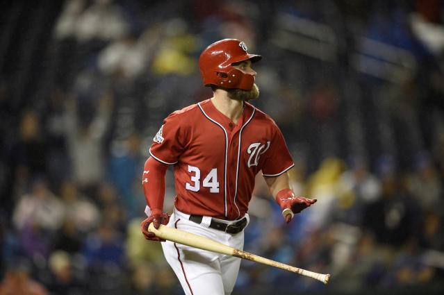 Washington Nationals' Bryce Harper watches his two-run home run during the seventh inning of the second baseball game of a doubleheader against the Chicago Cubs, Saturday, Sept. 8, 2018, in Washington. (AP Photo/Nick Wass)