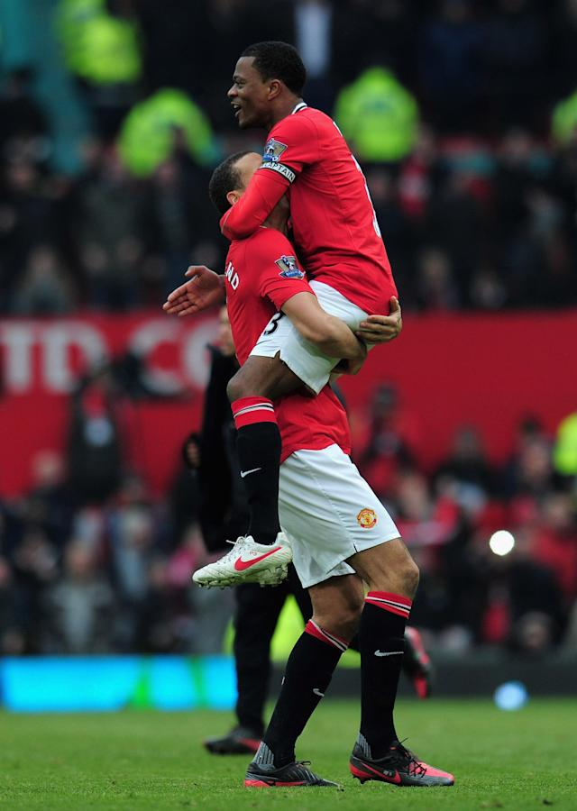 MANCHESTER, ENGLAND - FEBRUARY 11: Patrice Evra of Manchester United celebrates victory with Rio Ferdinand after the Barclays Premier League match between Manchester United and Liverpool at Old Trafford on February 11, 2012 in Manchester, England. (Photo by Shaun Botterill/Getty Images)
