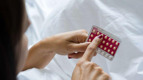 PHOTO: Stock image of woman holding birth control pills. (PhotoAlto/Getty Images)