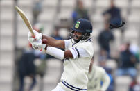 India's Cheteshwar Pujara is hit on his helmet on a delivery by New Zealand's Neil Wagner during the second day of the World Test Championship final cricket match between New Zealand and India, at the Rose Bowl in Southampton, England, Saturday, June 19, 2021. (AP Photo/Ian Walton)