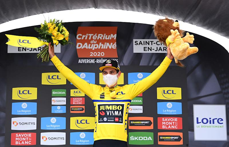SAINT CHRISTO EN JAREZ FRANCE AUGUST 12 Podium Wout Van Aert of Belgium and Team Jumbo Visma Yellow Leader Jersey Celebration Flowers Covid safety measures Mascot during the 72nd Criterium du Dauphine 2020 Stage 1 a 2185km stage from Clermont Ferrand to Saint Christo en Jarez 752m dauphine Dauphin on August 12 2020 in Saint Christo en Jarez France Photo by AnneChristine Poujoulat PoolGetty Images
