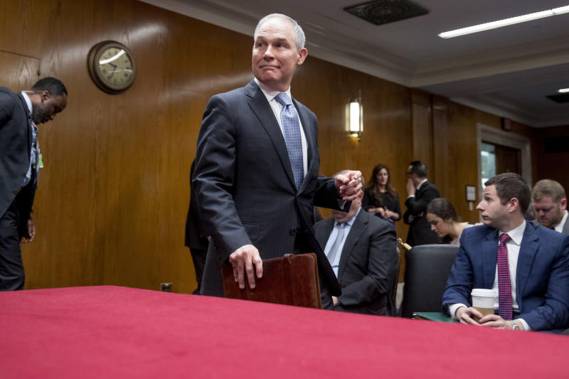 Environmental Protection Agency Administrator Scott Pruitt, accompanied by a member of his security, left, arrives to testify before a Senate Appropriations subcommittee on budget on Capitol Hill in Washington, Wednesday, May 16, 2018. Pruitt goes before a Senate panel Wednesday as he faces a growing number of federal ethics investigations over his lavish spending on travel and security. (AP Photo/Andrew Harnik)