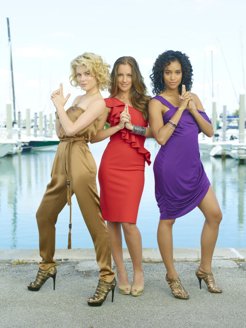 """In this undated image released by ABC, from left, Rachael Taylor, as Abby Sampson, Minka Kelly, as Eve, and Annie Ilonzeh, as Kate Prince, are shown from the ABC series, """"Charlie's Angels."""" The action series, which focused on three female detectives in Miami, has struggled in the ratings since its premiere last month. It's ABC's first cancellation of the new fall season.  (AP Photo/ABC, Bob D'Amico)"""