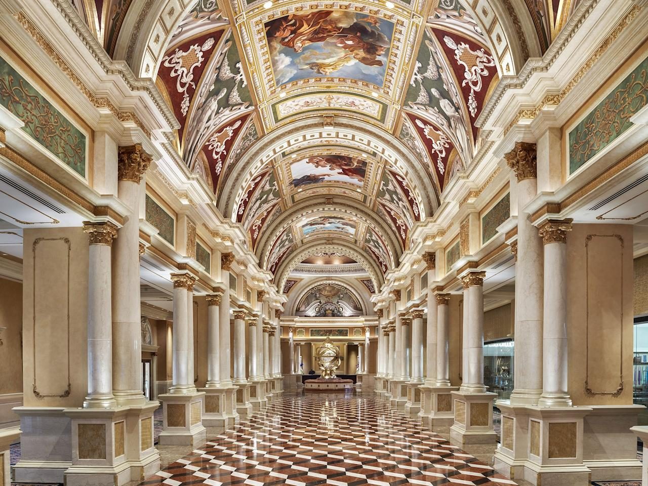"""<p><strong>How did it strike you on arrival?</strong><br> When you walk into The Venetian lobby, it's completely frescoed to its vaulted ceiling, and its centerpiece is a massive gilded sphere held up by four golden women. After having passed a replica of Venice's campanile and Rialto Bridge, arriving in this basilica-style registration area should feel totally cheesy....and yet, it is SO over-the-top and grand, you can't help but be impressed. Yes, even if you have actually been to real Venice. The Venetian and its sister tower, <a href=""""https://www.cntraveler.com/hotels/united-states/las-vegas/the-palazzo?mbid=synd_yahoo_rss"""">The Palazzo</a>, are both a part of The Venetian Resort.</p> <p><strong>What's the crowd like?</strong><br> The Venetian and Palazzo complex is so enormous—more than 7,000 rooms and three million square feet of retail and meeting space, there's absolutely no way to categorize the travelers you see at this hotel. They run the gamut from conventioneers of all kinds to people who know and love the Venetian, to people checking in to the massive Canyon Ranch that spans both hotels.</p> <p><strong>The good stuff: Tell us about your room.</strong><br> The Venetian has made much of how all of its rooms are suites. They are all quite large (the standard size is 650 square feet, and they go up from there). Especially if you are here on business, the step down in each room from sleeping area to a small living room, with desk and big flat screen television, makes a huge psychological difference. All of the suites have been recently refreshed, too, to keep pace with Strip-wide renovations. I've stayed in both a Luxury Suite (the standard, with a king-sized bed) and a Bella Suite (essentially the same layout, slightly larger, with two queens). All done with cream-colored walls and neutral carpets but with jewel-toned accent chairs, they're more modern and definitely lighter than they were a few years ago.</p> <p><strong>We're craving some deep, restorative"""