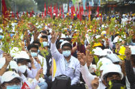 Students from the University of Medicine protest with brunches of Eugenia plants during an anti-coup protest in Mandalay, Myanmar, Sunday, Feb. 21, 2021. Police in Myanmar shot dead a few anti-coup protesters and injured several others on Saturday, as security forces increased pressure on popular revolt against the military takeover. (AP Photo)