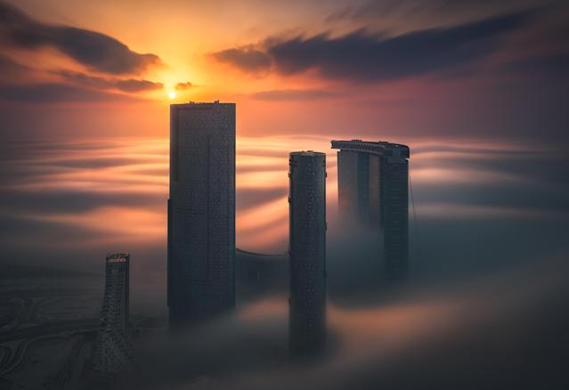 <p>Tall buildings at sunset. (Photograph by Khalid Alhammadi/Caters News) </p>