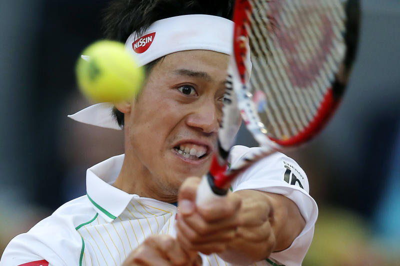 Kei Nishikori from Japan returns the ball during his Madrid Open tennis tournament final match against Rafael Nadal from Spain in Madrid, Spain, Sunday, May 11, 2014. (AP Photo/Andres Kudacki)