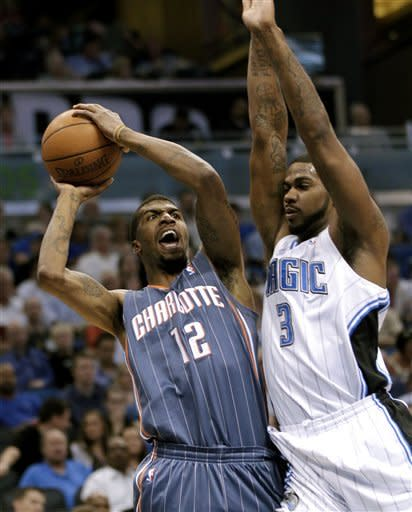 Charlotte Bobcats' Tyrus Thomas (12) draws a foul from Orlando Magic's Earl Clark (3) as he attempts a shot during the first half of an NBA basketball game, Wednesday, April 25, 2012, in Orlando, Fla. (AP Photo/John Raoux)