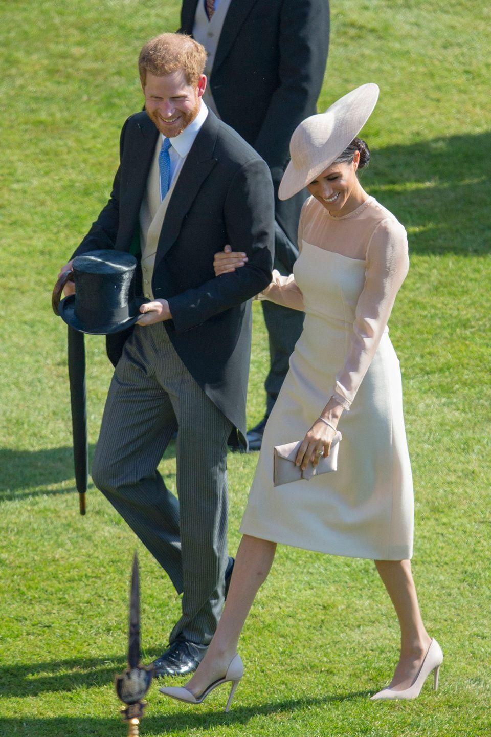 <p>In their first public appearance as husband and wife after the wedding, Meghan lovingly walked arm-in-arm with Harry as they attended Prince Charles' 70th Birthday Patronage Celebration in the grounds of Buckingham Palace.</p>