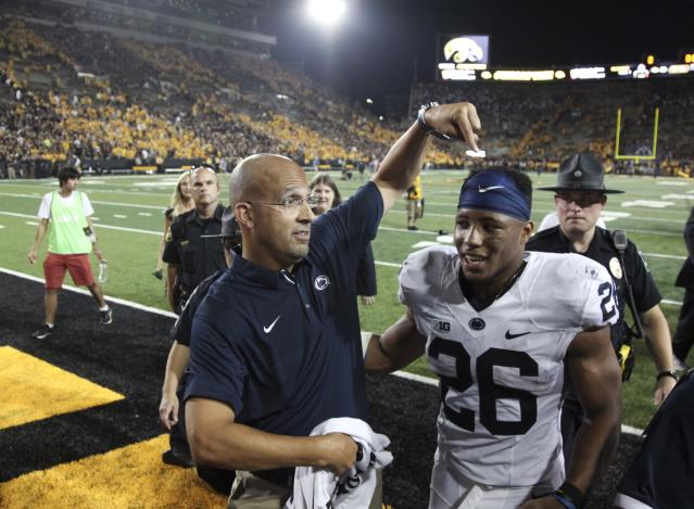 "<a class=""link rapid-noclick-resp"" href=""/ncaaf/players/256698/"" data-ylk=""slk:Saquon Barkley"">Saquon Barkley</a> (R) was the best player on the field vs. Iowa on Saturday. (Getty Images)"