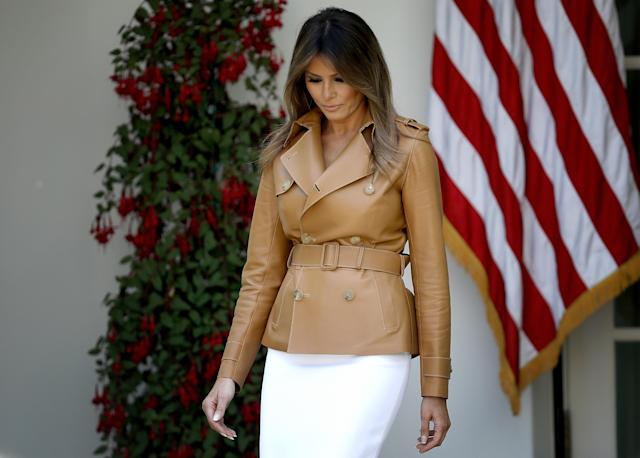<p>Speaking to crowds in front of the White House in May 2018, Melania opted for a white pencil skirt and a tan brown leather Ralph Lauren jacket worth £4,436. She completed the look with white Christian Louboutin heels (not pictured). [Photo: Getty] </p>