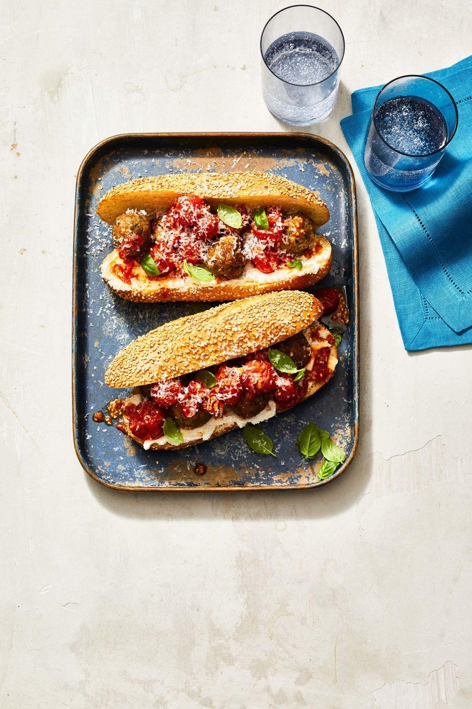 """<p>Featuring tender meatballs on a toasted hero roll with creamy ricotta and fresh tomato sauce, this makes a tasty family dinner that'll have everyone asking for seconds.</p><p><em><a href=""""https://www.goodhousekeeping.com/food-recipes/a37199514/meatball-sub-sandwich-recipe/"""" rel=""""nofollow noopener"""" target=""""_blank"""" data-ylk=""""slk:Get the recipe for Air Fryer Meatball Sub »"""" class=""""link rapid-noclick-resp"""">Get the recipe for Air Fryer Meatball Sub »</a></em></p><p><strong>RELATED: </strong><a href=""""https://www.goodhousekeeping.com/food-recipes/g605/family-style-recipes/"""" rel=""""nofollow noopener"""" target=""""_blank"""" data-ylk=""""slk:75 Easy, Delicious Family Dinner Ideas For Any Day of the Week"""" class=""""link rapid-noclick-resp"""">75 Easy, Delicious Family Dinner Ideas For Any Day of the Week</a><br></p>"""