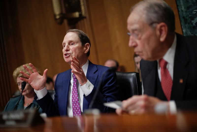 Sen. Ron Wyden, D-Ore., left, gestures while asking questions as Sen. Chuck Grassley, R-Iowa, right, chairman of the Senate Finance Committee, looks on during a hearing with drug company CEOs on drug prices, Tuesday, Feb. 26, 2019 on Capitol Hill in Washington. Also on the committee is Sen. Debbie Stabenow, D-Mich. (AP Photo/Pablo Martinez Monsivais)
