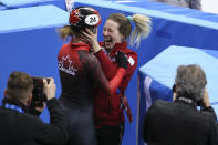 <p>Kim Boutin of Canada (with the helmet) celebrates winning the bronze medal after Choi Minjeong of South Korea is disqualified following the Ladies' 500m Short Track Speed Skating final on day four of the PyeongChang 2018 Winter Olympic Games at Gangneung Ice Arena on February 13, 2018 in Gangneung, South Korea. (Photo by Jean Catuffe/Getty Images) </p>