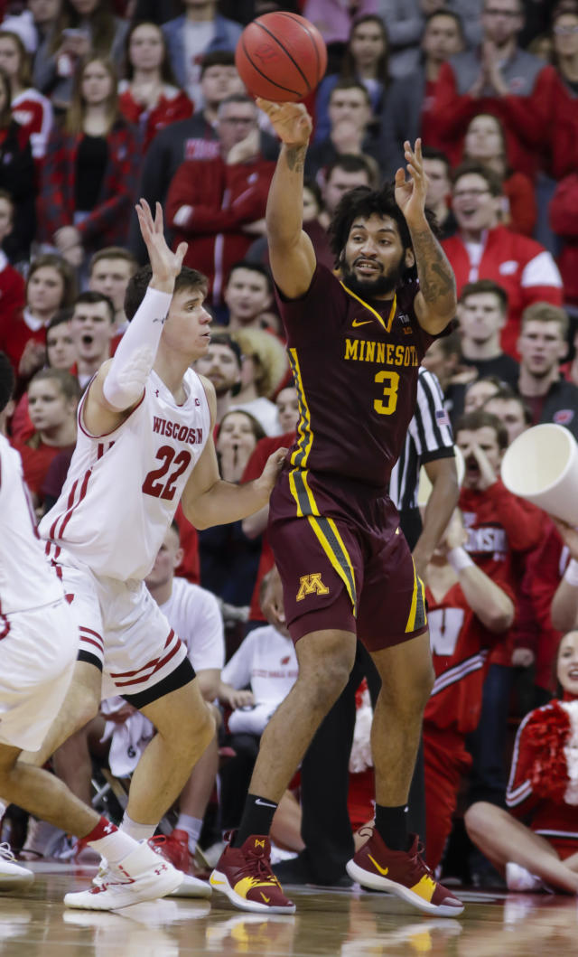 Minnesota's Jordan Murphy (3) passes the ball as Wisconsin's Ethan Happ (22) defends during the second half of an NCAA college basketball game Thursday, Jan. 3, 2019, in Madison, Wis. Minnesota won 59-52. (AP Photo/Andy Manis)