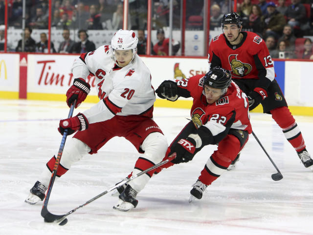 Ottawa Senators Nikita Zaitsev (22) attempts to steal the puck from Carolina Hurricanes Sebastien Aho (20) during first period NHL hockey action in Ottawa, Saturday Nov. 9, 2019. (Fred Chartrand/The Canadian Press via AP)