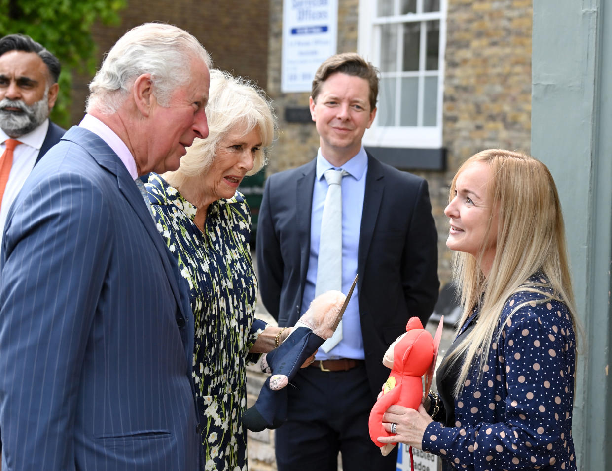 CLAPHAM, ENGLAND - MAY 27: Prince Charles, Prince of Wales and Camilla, Duchess of Cornwall who gets presented with a Boris Johnson dog toy during a visit to Clapham old town on May 27, 2021 in Clapham, England. (Photo by Karwai Tang/WireImage)