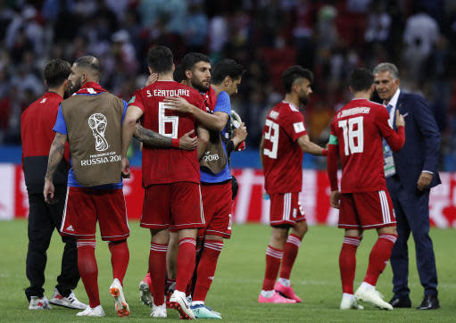 Iran's players react at the end of the group B match between Iran and Spain at the 2018 soccer World Cup in the Kazan Arena in Kazan, Russia, Wednesday, June 20, 2018. Spain won 1-0 (AP Photo/Manu Fernandez)