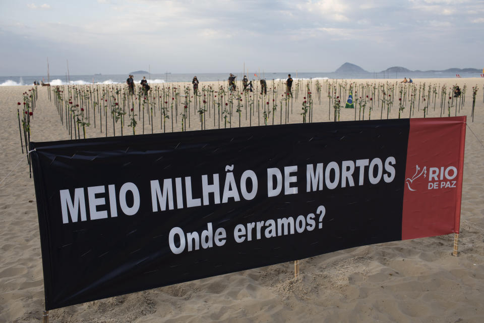 """A banner that reads, """"Half Million Dead. Where did we go wrong?"""" is seen in the sand on Copacabana beach in honor of 500,000 deaths during a protest against Brazilian President Jair Bolsonaro and his handling of the COVID-19 pandemic, in Rio de Janeiro, Brazil, Sunday, June 20, 2021. Brazil's COVID-19 death toll surpassed the milestone of 500,000 deaths on Saturday night. (AP Photo/Silvia Izquierdo)"""