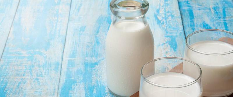 Container and glasses of milk